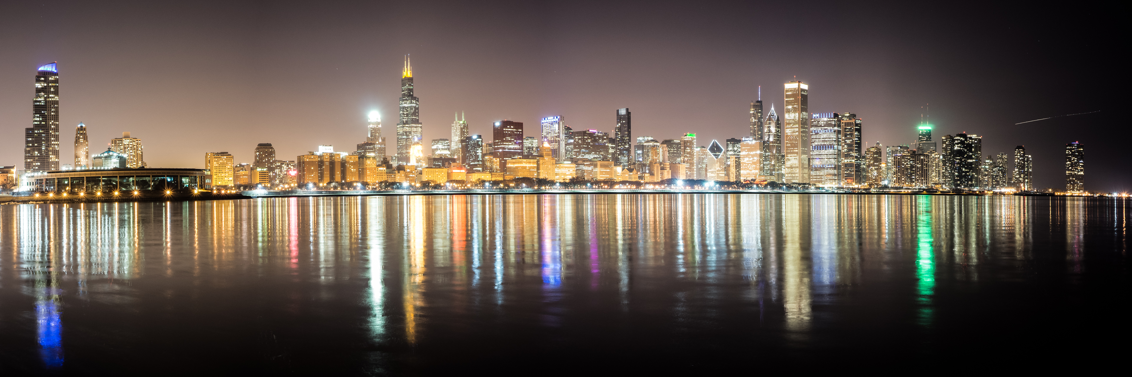 A long Exposure of Chicago's skyline off of Lake Michigan at night.