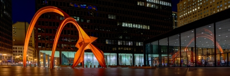Calder's Flamingo in Chicago's Federal Plaza has a reflection in the US Post Office.