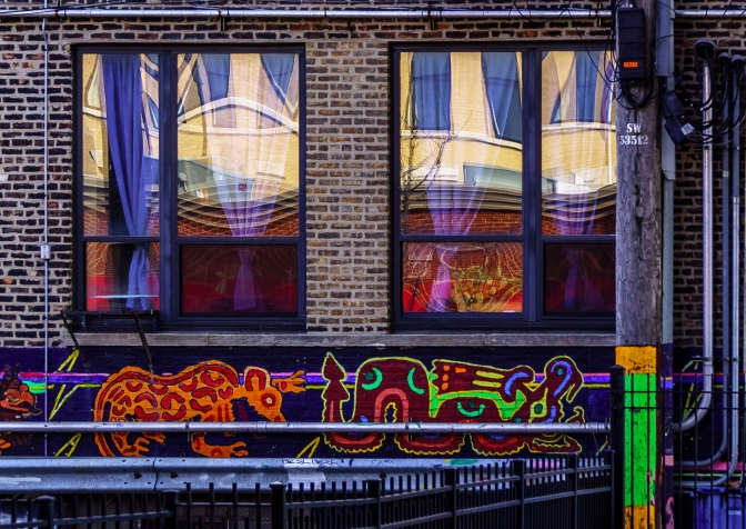 Latin American art under the windows and in the shadow of the L in Pilsen, Chicago, close to 17th street.
