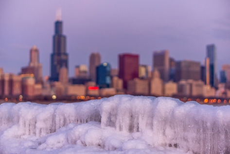 The Chicago Skyline placed above the a small icewall closed to the Planetarium.