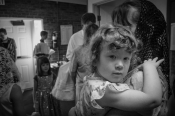 This was taken at a baptism of my youngest niece. This is her next oldest sister, being held by her mother. The light here was really a wild mix of cool and warm tones and confusing my eye, so I switched to black and white to center on her expression. She's a lovely little girl.